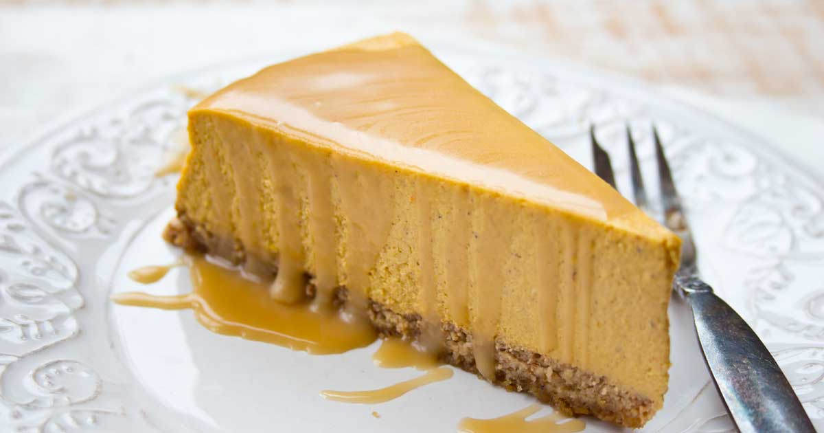 a slice of low carb pumpkin cheese cake with topped with sugar free maple caramel sauce