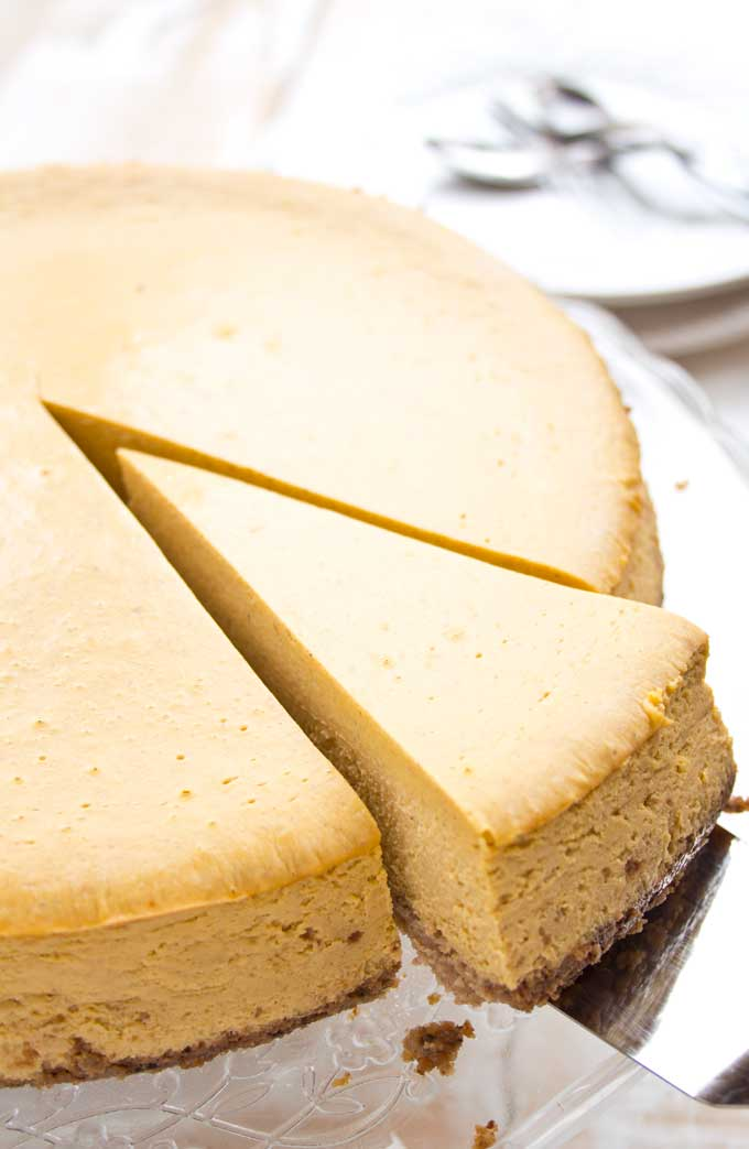 serving one slice of low carb pumpkin cheesecake