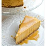 a slice of pumpkin cheesecake with salted caramel drizzle on a plate