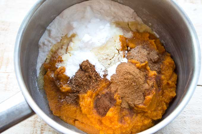 Preparing low carb pumpkin cheesecake - pumpkin puree, spices and sweetener in a saucepan