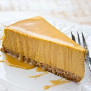 a slice of low carb pumpkin cheesecake on a plate and a fork