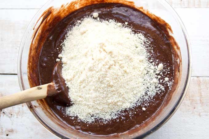 Adding almond flour to the chocolate cake mix