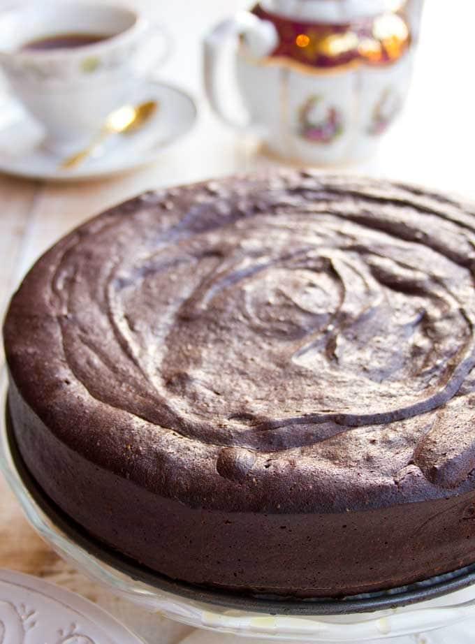 A keto chocolate cake on a cake stand