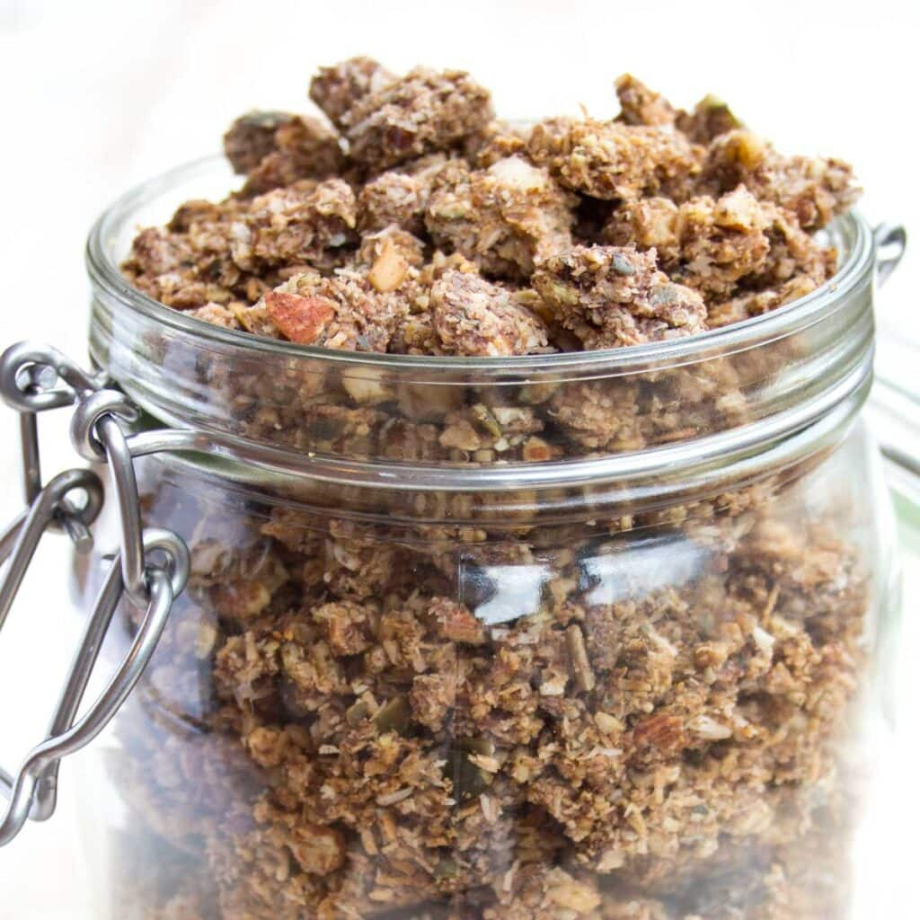 a glass jar with keto granola