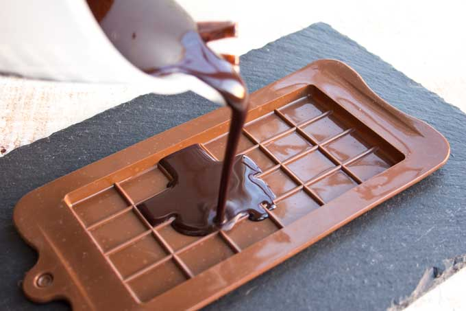 pouring chocolate into a silicone mould