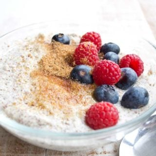 a bowl of keto low carb porridge with golden erythritol and berries