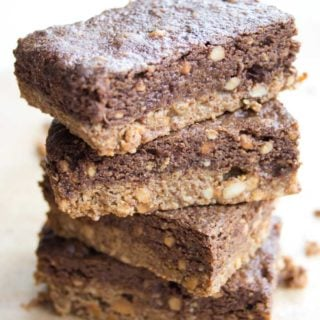 a stack of four peanut butter protein bars