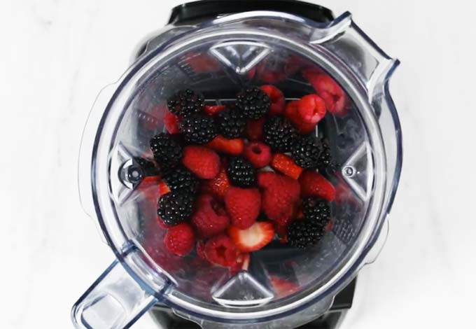strawberries, raspberries and blackberries in a food processor