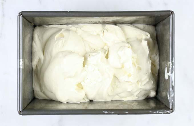 a metal bread tin with sugar free vanilla ice cream