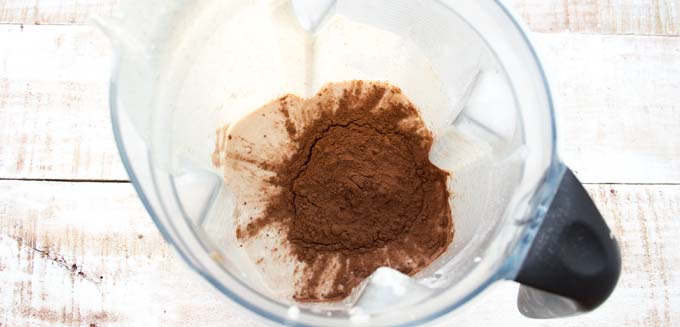 cocoa powder and peanut butter mix in a blender