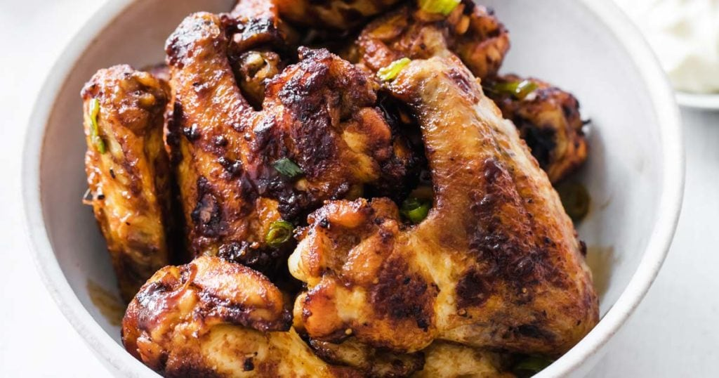 closeup of a bowl of crispy bbq chicken wings