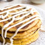 a stack of low carb cinnamon swirl pancakes with cream cheese frosting