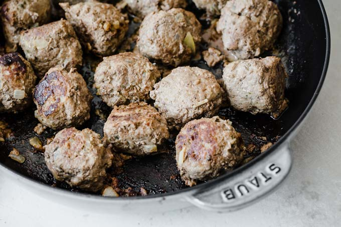 fried beef meatballs in a cast iron pan