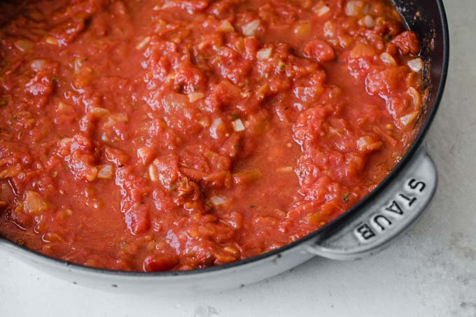 tomato sauce in a cast iron pan