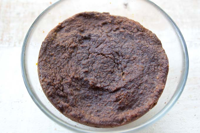 a baked chocolate mug cake in a glass bowl