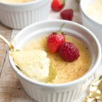 a ramekin with dairy free vanilla custard and a spoon