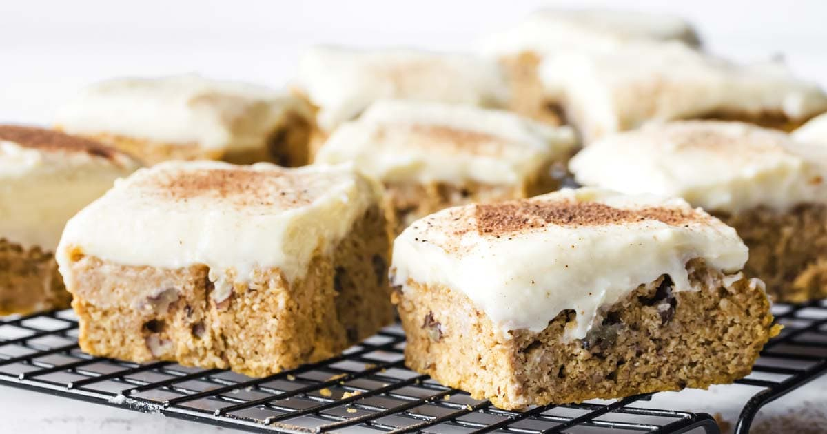 low carb pumpkin bars with cream cheese frosting on a cooling rack
