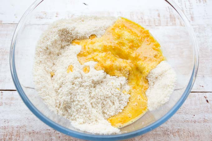 almond flour and a mix of egg, orange zest and coconut oil in a bowl
