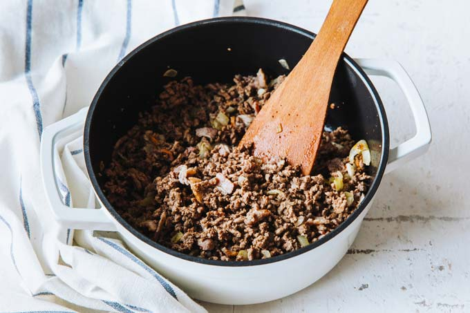 browning ground beef in a saucepan