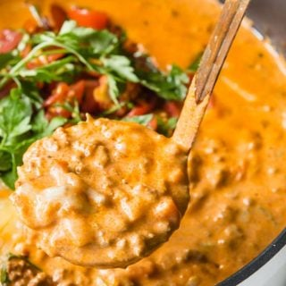 a ladle filled with creamy cheeseburger soup