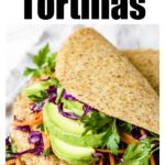 a stack of keto low carb tortillas filled with chicken, avocado ad slaw