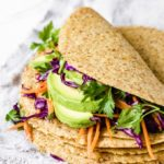 low carb tortilla filled with avocado and other fresh vegetables