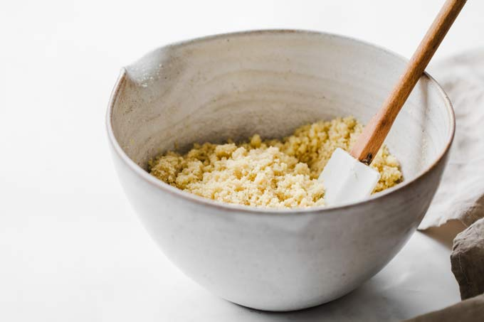 almond flour and butter crumble in a bowl and a spatula