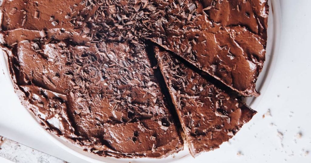 keto chocolate cheesecake with a slice cut out