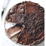 a chocolate cheesecake and a knife
