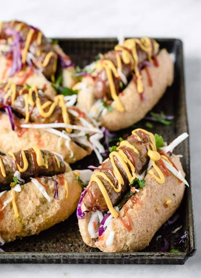 keto hot dogs with sausages and topped with mustard and ketchup