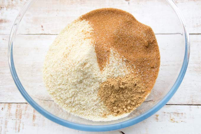 a bowl with almond flour, brown erythritol and spices