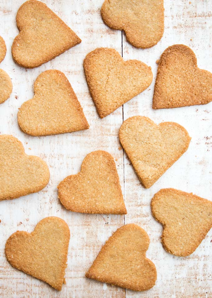 heart shaped keto ginger cookies on a wooden surface