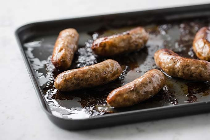 grilled sausages on a baking sheet