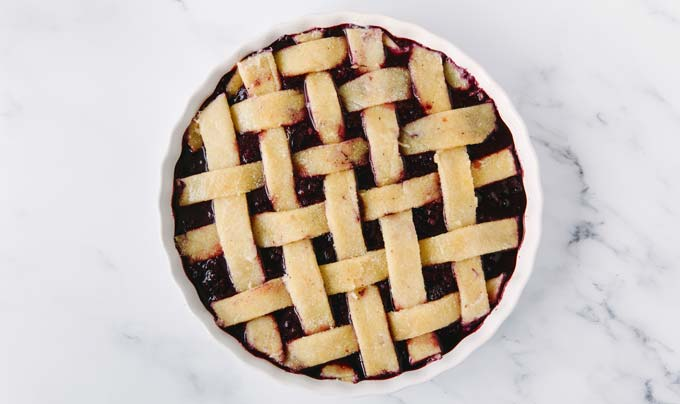 mixed berry pie with lattice fathead crust before baking