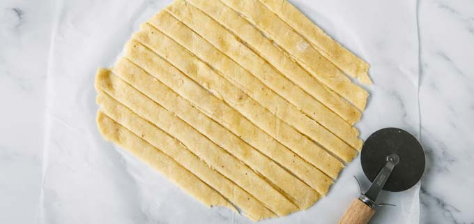 rolled out fathead dough cut into strips
