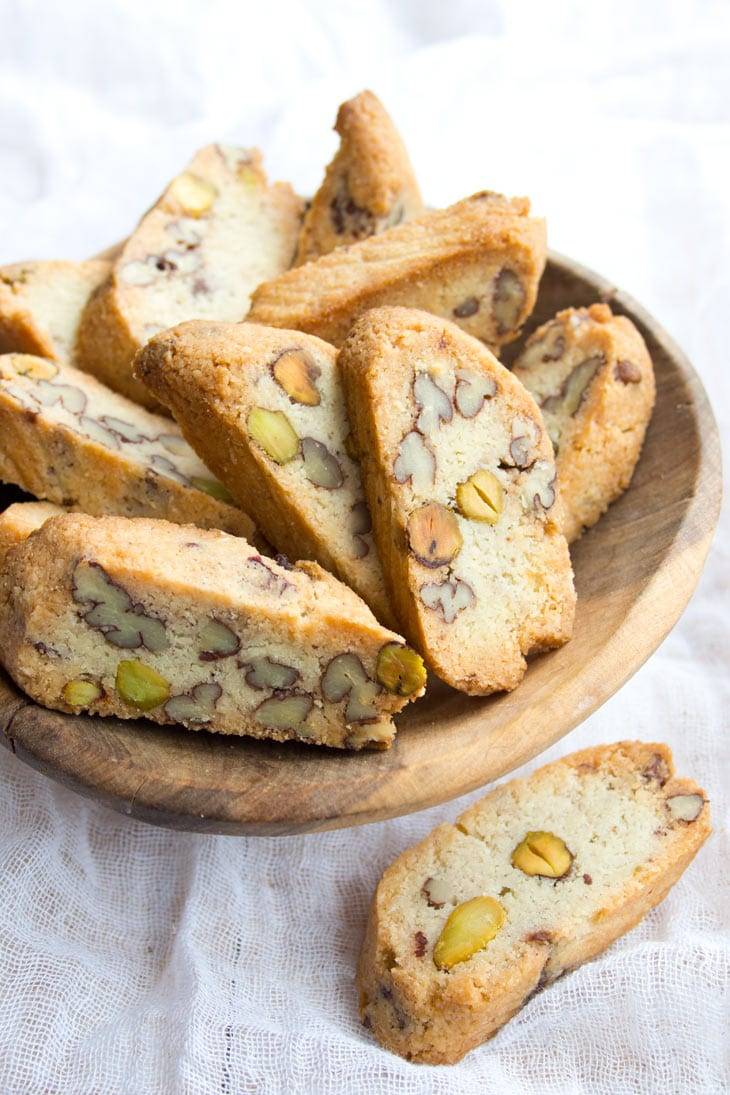 keto biscotti studded with pecans and pistachios in a wooden bowl