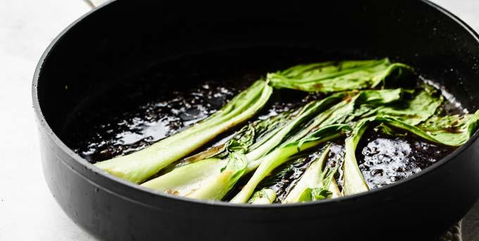 bok choi in a cast iron pan
