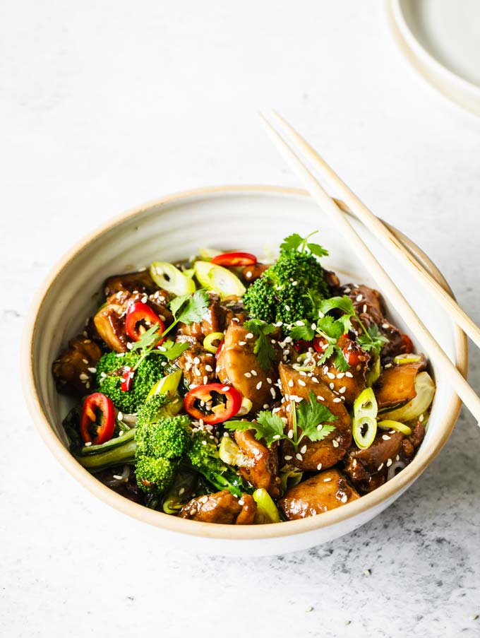 keto teriyaki chicken with green vegetables in a bowl with chopsticks in a