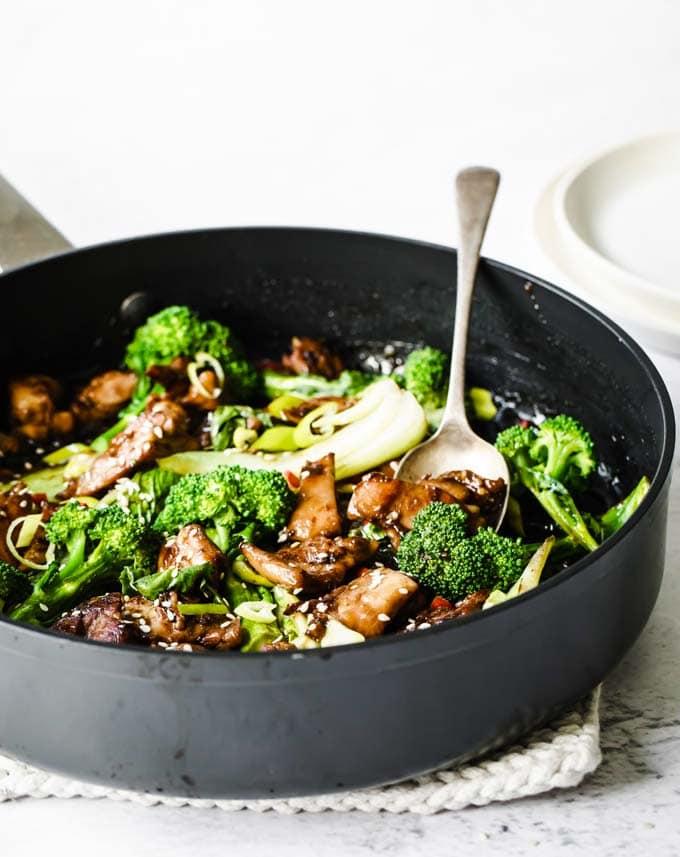 a cast iron pan with keto teriyaki chicken stir fry