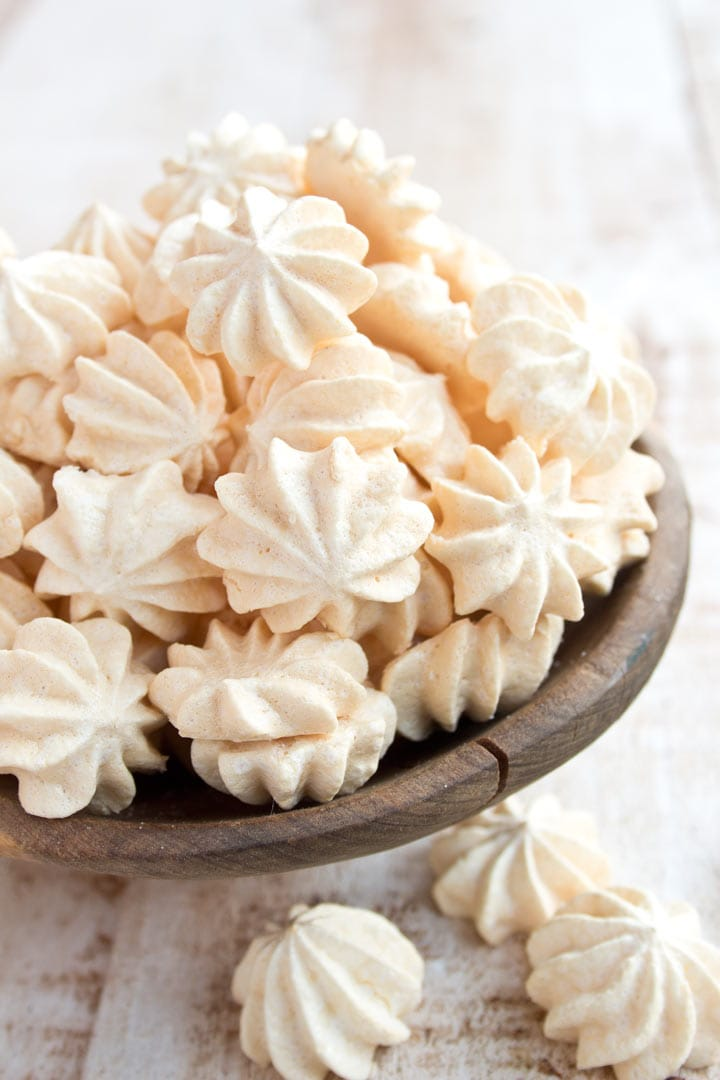 piped small sugar free meringues heaped in a bowl