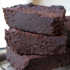 a stack of three keto brownies