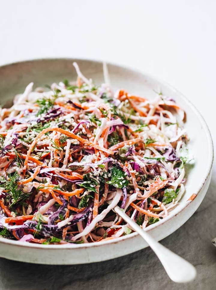 a keto coleslaw with a spoon in a bowl