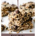 a stack of keto chocolate chip granola bars topped with melted chocolate