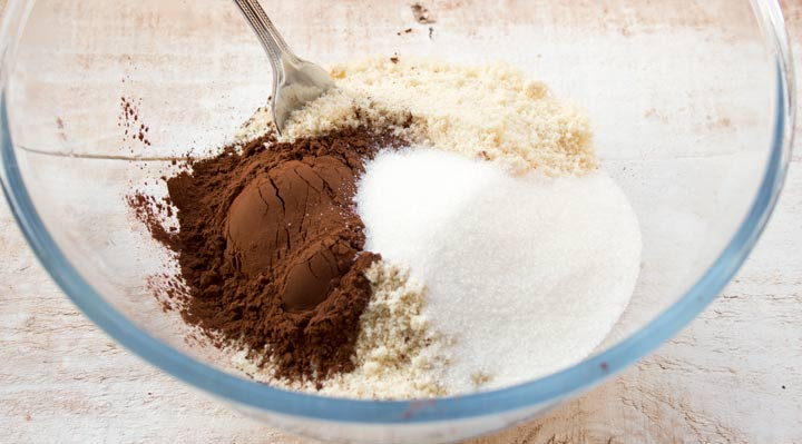 a bowl with almond flour, erythritol and cocoa powder