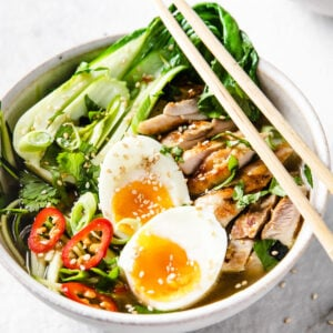 a bowl of keto chicken ramen with chopsticks