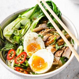 a bowl of keto chicken ramen with chopsticks