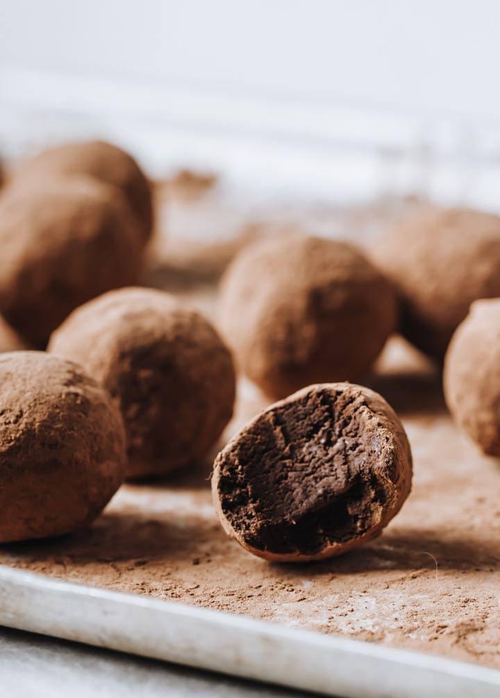 keto truffles on a tray, one bitten