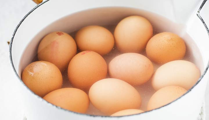 boiling eggs in a saucepan