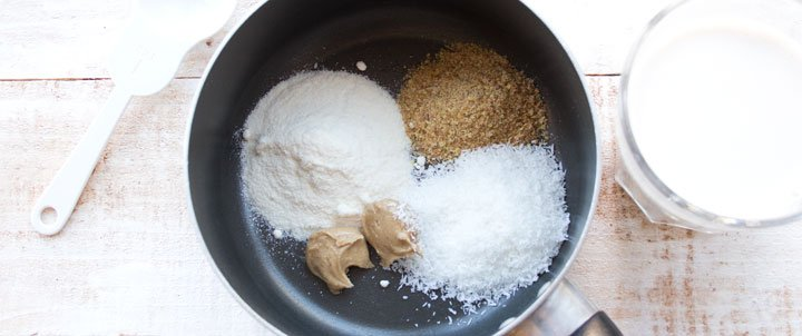 coconut flour, flaxmeal, sweetener and nut butter in a saucepan and a glass of milk