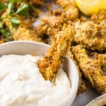 baked coated zucchini fries and a dip